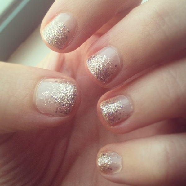 Gold Glitter Ombre Tips Over Neutral Nails
